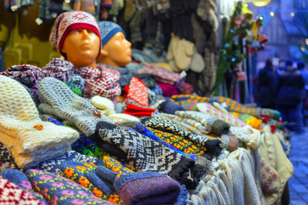 Woolen scarves and mittens with a national Latvian design in a stall at the Christmas Fair in Riga