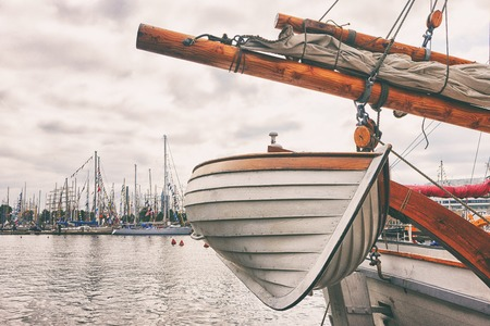 A wooden boat aboard a sailing ship in the port of Riga during the regatta