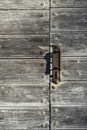 Closed with an iron handle door of boards with iron rivets