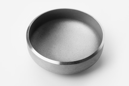 Steel caps for metal pipes in industrial production and maintenance of pipes