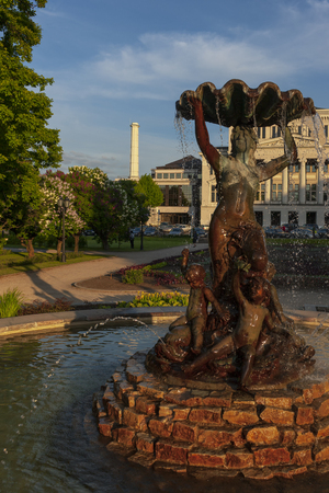 Fountain in the form of a woman with a sink in the park of the Latvian National Theater of Opera and Ballet in Rigk