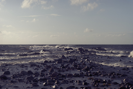 Stones on the beach of the Baltic Sea in the waves of the storm summer... Stock Photo
