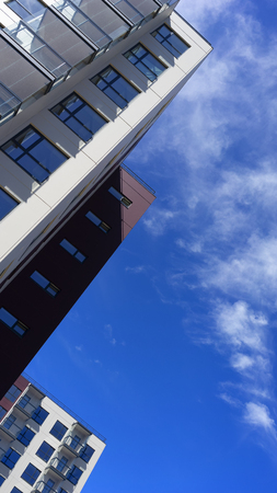 New modern apartment buildings in the background of a blue sky with clouds