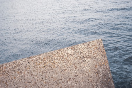 Concrete reinforcement with stone points against the waves of the Baltic Sea Stock Photo