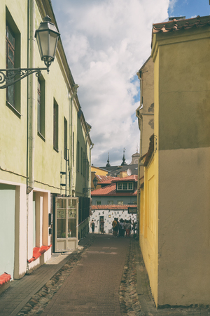 Narrow street of the old city of Vilnius overlooking the church spiers on a summer day