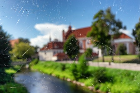 Landscape on the castle and the river through the web on the bridge over the river Vilnia in Vilnius Фото со стока