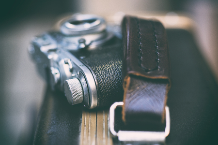 Vintage camera with chrome details on a suitcase with a leather handle Фото со стока