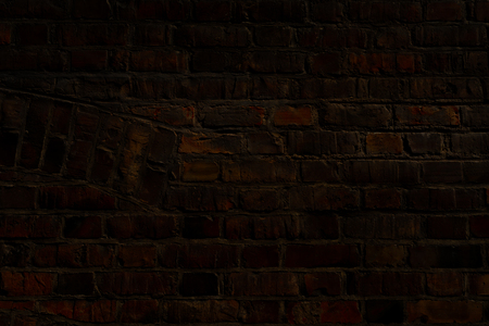 Brick wall of an old house with a tile of different directions in the form of an organ in a dark key for a background Stock Photo