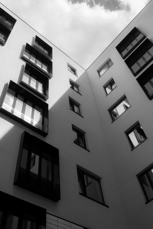 The geometry of the windows on the facade with light and shadow in black and white stylization Stock Photo