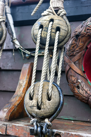 Fragments of rigging with ropes of a wooden sailing vessel with decorative elements Stok Fotoğraf