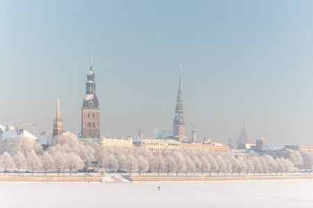 Panorama of the capital of Latvia, the city of Riga by the Daugava River in frozen snow in January