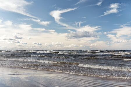 Evening with a strong wind and waves on a deserted Baltic beach in September. Jurmla. Latvia Reklamní fotografie