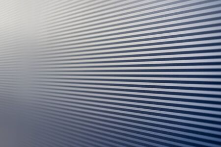 Blue lines on the wall of the house with highlights from daylight