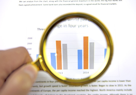 Magnifying glass zoom on a business chart Stock Photo