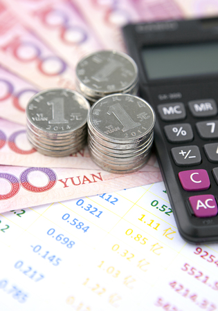 calculator chinese: Chinese currency,accounting bills and calculator Stock Photo