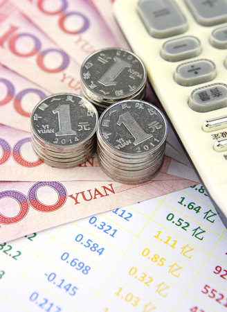 calculator chinese: Chinese currency,chart and calculator Stock Photo