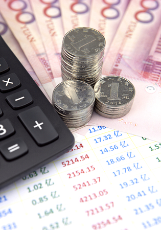 calculator chinese: Chinese currency and coins with accounting bill and calculator