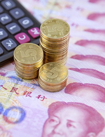 calculator chinese: Coins,calculator and chinese banknotes