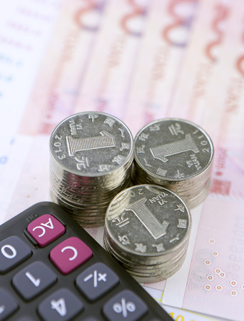 calculator chinese: Chinese coins,banknotes and calculator