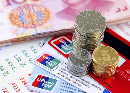 finacial: finacial concept - coins,chinese currency,account bill and bank cards