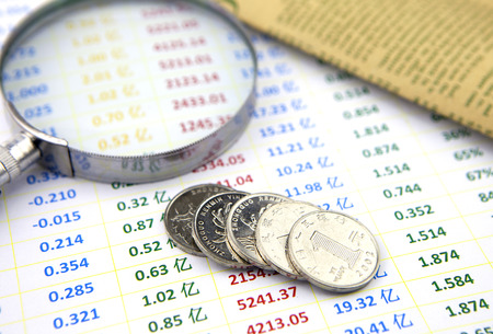 metalline: Magnifier and coins on data sheet