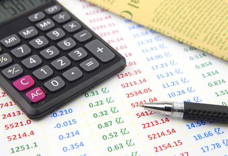 ballpen: Ball-pen and calculator on data cheet Stock Photo