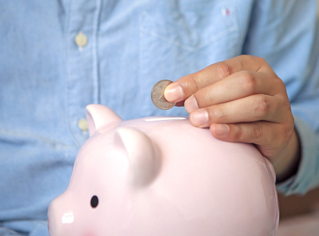 man holding money: Save money Stock Photo
