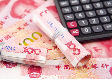 calculator chinese: Calculator and chinese banknotes