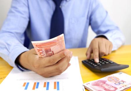 calculator chinese: Accountant at work Stock Photo