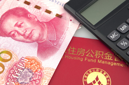 calculator chinese: Chinese banknotes,calculator and housing accumulation fund bankbook on white background