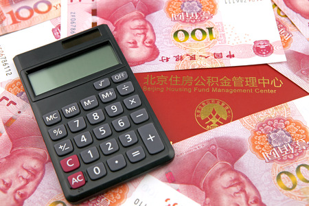 calculator chinese: Chinese money and calculator with housing accumulation fund bankbook Editorial