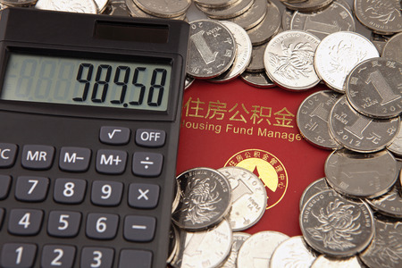 A lot of coins and calculator on the background of housing accumulation fund bankbook Editorial