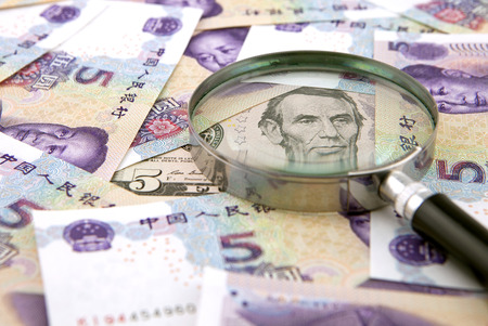 devaluation: US dollar against china yuan and a magnifier
