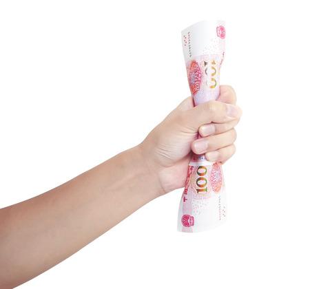 squeezing: Hand squeezing bunch of renminbi