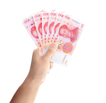Hand with chinese banknotes
