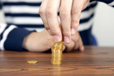 The merchant stacked coins Stock Photo