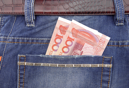 monetary concept: One hundred yuan bills in the pocket Stock Photo