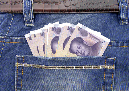 yuan: Five yuan at jeans pocket Stock Photo