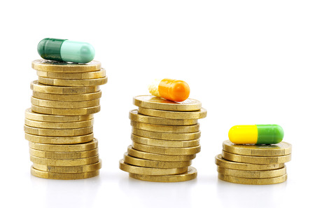 medical expenses: Coins and capsule medical expenses Stock Photo