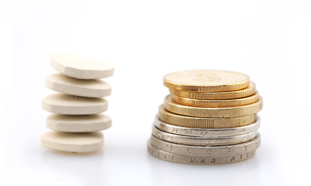 drugs on coins Stock Photo