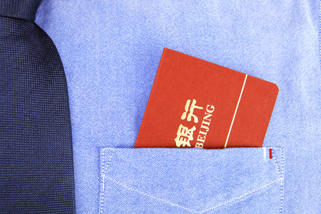 monetary concept: bank book in pocket
