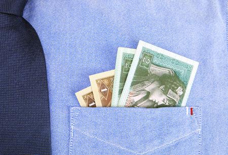 strapped: Pocket change Stock Photo