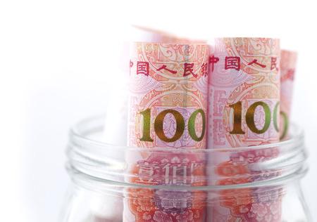 arrears: Paper money in a glass bottle Stock Photo