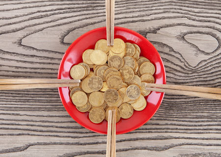 earned: A set of coins and four pairs of chopsticks