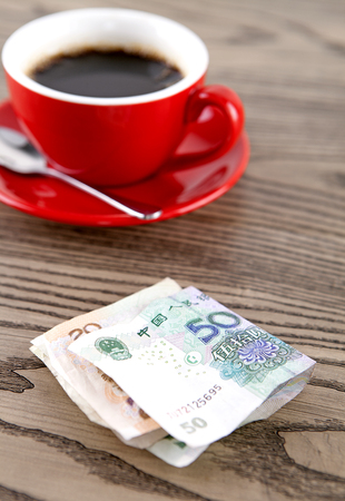 gules: A cup of coffee and RMB cash