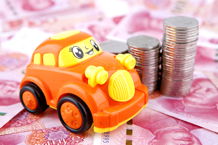 Money with toy car