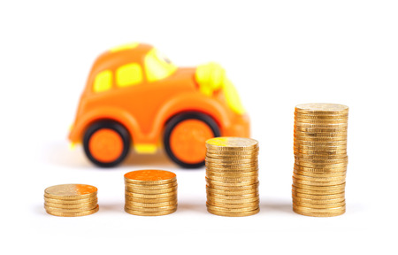 Toy cars and a row of coins