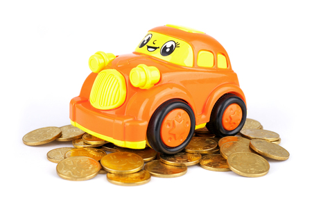 matting: Car models on coins Stock Photo