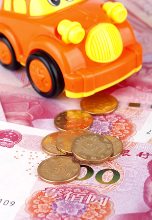 Cars and Renminbi Stock Photo