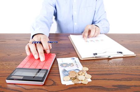 Calculating income businessman Lizenzfreie Bilder